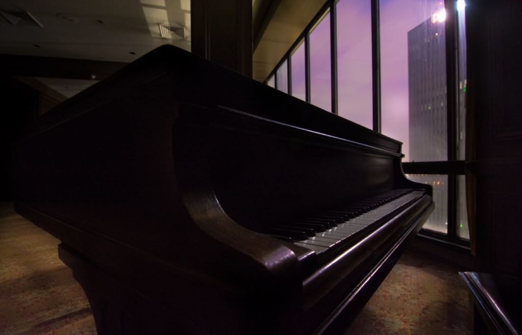 baby grand piano in abandoned hotel